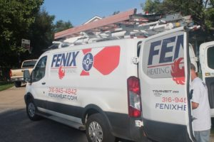 Fenix Heating & Cooling van parked in a West Wichita neighborhood near Maize Rd.