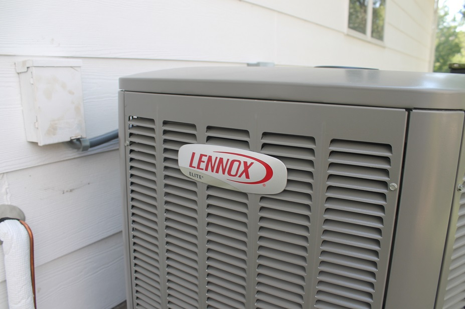 Lennox air conditioner getting installed at a West Wichita home