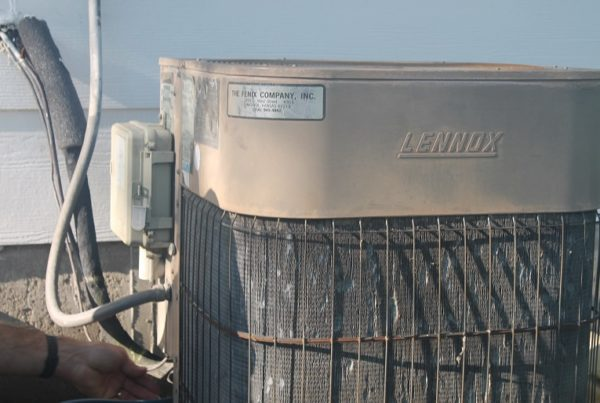 Old Lennox air conditioner outside a West Wichita home