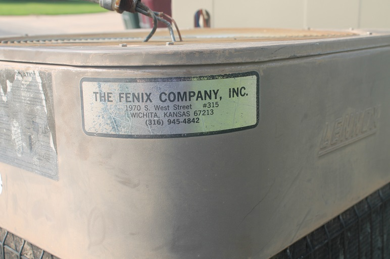 Sticker on old AC unit saying Fenix Company, Inc out of Wichita