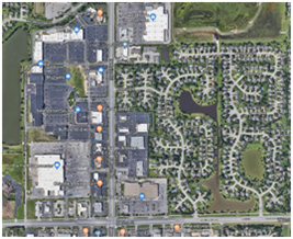 Aerial view of a portion of ICT near Maize road that shows residential neighborhood and the commercial area that includes New Market Square