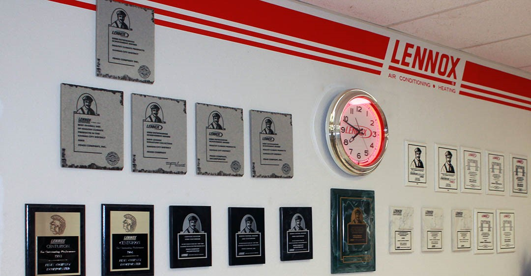 Fenix Heating & Cooling Wichita showroom with many service awards on the wall